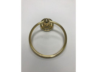 Toallero circular de bronce marca JADO.